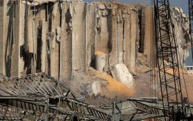 Rescuers and civil defence gather at Beirut port's silo on 5 August 2020 in the aftermath of a massive explosion in the Lebanese capital. Picture: AFP