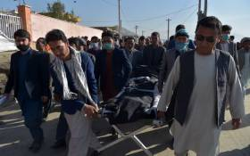 Shiite mourners carry the body of a schoolgirl, who died in multiple blasts outside a girls' school, for burial in Dasht-e-Barchi on the outskirts of Kabul on 9 May 2021, as the death toll has risen to 50, the interior ministry said. Picture: AFP