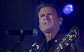 FILE: Johnny Clegg performs at Grandwest Arena, on 30 June 2017 in Cape Town, on the first live gig of his final world tour.  Picture: AFP
