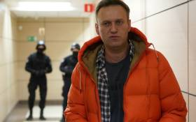 FILE: Russian opposition leader Alexei Navalny stands near law enforcement agents in a hallway of a business centre, which houses the office of his Anti-Corruption Foundation (FBK), in Moscow on 26 December 2019. Picture: AFP