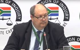 A screenshot of former Crime Intelligence official Kobus Roelofse appearing at the state capture inquiry on 19 September 2019. Picture: SABC Digital News/Youtube