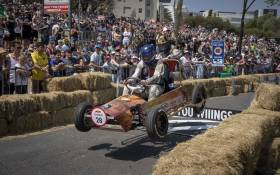 A box cart launches off a ramp while heading down the race course at the Red Bull Box Cart Races. Picture: Thomas Holder/EWN
