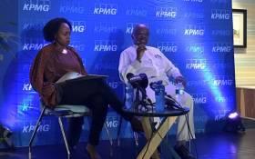 FILE: KPMG CEO Nhlamu Dlomu (left) and KPMG chairperson Wiseman Nkuhlu (right) speak at a media briefing on 15 April 2018. Picture: Katleho Sekhotho/EWN.