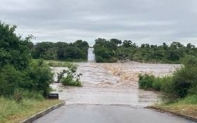Storm water covers the low bridge outside Skukuza, over the Sabie River. Picture: SANParks.