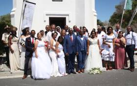 12 Couples stand in front of a small church on Robben Island after getting married on Valentines Day. Picture: Bertram Malgas