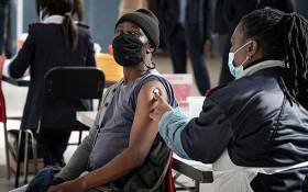 An education department employee gets a COVID-19 vaccine shot at the Rabasotho community hall in Tembisa on 23 June 2021. Picture: Xanderleigh Dookey Makhaza/Eyewitness News