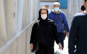 Iranians wear face masks as a COVID-19 coronavirus pandemic precaution, in Iran's capital Tehran on 14 October 2020. Picture: AFP.