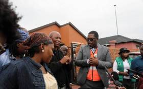 Acting Gauteng Social Development MEC Panyaza Lesufi on 31 March 2020 met with the family of Ellen Mbhele (66) who died just outside a Sassa pay point in Pimville, Soweto, on 30 March 2020. Picture: Kayleen Morgan/EWN.
