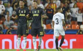 Juventus forward Cristiano Ronaldo (L) reacts next to teammate Federico Bernardeschi after receiving a red card during the UEFA Champions League group H football match between Valencia CF and Juventus FC at the Mestalla stadium in Valencia on 19 September, 2018. Picture: AFP