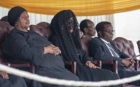 Robert Mugabe's family including his wife, Grace (veiled,) sits and watches on as members of the public view the body of the former president. Picture: Thomas Holder/EWN