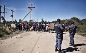 FILE: Police monitoring protesters in Mahikeng who are calling for the removal of North West Premier Supra Mahumapelo on 20 April 2018. Picture: Ihsaan Haffejee/EWN.