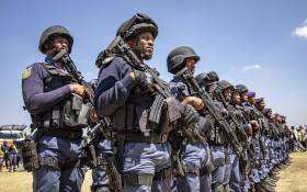 Members of the Tactical Response Team and National Intervention Unit prepare for deployment into the Westbury area. The team is tasked with addressing gang and drug related crimes that have plagued the community here for years. Picture: Thomas Holder/EWN