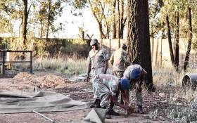 An SANDF technical team works to restore infrastructure at the polluted Vaal River system. Picture: @SANDFCorpEvents/Twitter