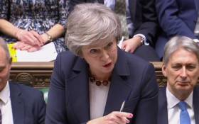 A video grab from footage broadcast by the UK Parliament's Parliamentary Recording Unit shows Britain's Prime Minister Theresa May as she speaks during the weekly Prime Minister's Questions in the House of Commons in London on 9 January 2019. Picture: AFP.
