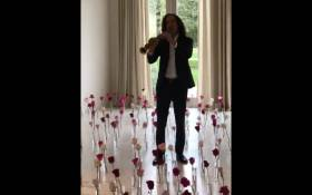 A screengrab of Kenny G playing music for Kim Kardashian West on Valentine's Day.
