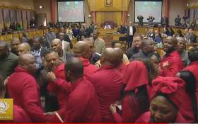EFF MPs are thrown out during Pravin Gordhan's Public Enterprises budget vote. Picture: Parliament YouTube.