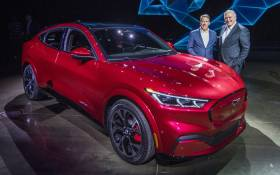 Ford CEO James Hackett (R) and a team member reveal the company's first mass-market electric car the Mustang Mach-E, which is an all-electric vehicle that bears the name of the company's iconic muscle car at a ceremony in Hawthorne, California on 17 November 2019. Picture: AFP