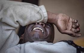 FILE: An injured man covers his face during election protests in Zimbabwe on 1 August 2018. Picture: Thomas Holder/EWN.