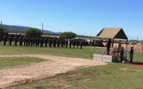 President Cyril Ramaphosa gets a briefing from the military as Silver Falcons sporadically fly overhead in an aerial display during Freedom Day celebrations in Makhanda on 27 April 2019. Picture: Carien du Plessis/EWN