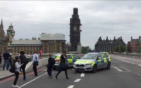 A video grab taken from AFP TV video footage shows police officers cordoning off Westminster Bridge, leading to Parliament Square in central London on 14 August 2018, after a car was driven into barriers at the Houses of Parliament. Picture: AFP.