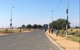 Rabie Ridge residents throw stones at alleged land invaders during a protest on 15 April 2019. Picture: Edwin Ntshidi/EWN
