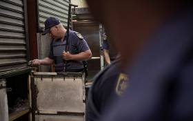 Members of the South African Police Services raiding one of the shops in Johannesburg CBD on 6 August 2019.Picture: Sethembiso Zulu/EWN