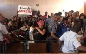 Community members pack the Goodwood magistrates court on 21 February 2020 where the man accused of murdering Tazne van Wyk (8) is due to appear. Picture: Lizell Persens/EWN
