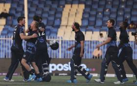 Namibia's cricketers celebrate their victory at the end of the ICC men's Twenty20 World Cup cricket match between Namibia and Ireland at the Sharjah Cricket Stadium in Sharjah on 22 October 2021. Picture: Karim Sahib/AFP.