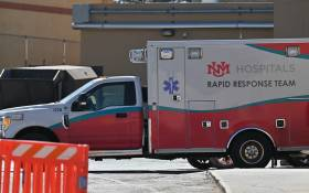An exterior view shows an ambulance parked at the University of New Mexico Hospital, where Rust director of photography Halyna Hutchins was transported and later pronounced dead after being injured during filming, on 22 October 2021. Picture: Sam Wasson/Getty Images via AFP