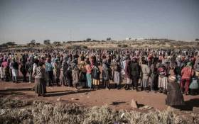 Residents of Iterileng informal settlement near Laudium queue for food packages on 20 May 2020. Picture: Abigail Javier/EWN
