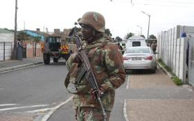 SANDF soldier on patrol in Manenberg. The military has released their soldiers to help stabilise gang hotspots, while law enforcement agencies conducted raids in the area. Picture: Bertram Malgas/EWN