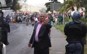 FILE: Western Cape MEC for Safety and Security Dan Plato pictured before addressing the Ocean View community amid protest. Photo: Bertram Malgas/EWN