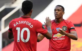 Manchester United's striker Anthony Martial (R) celebrates scoring the opening goal with teammate Marcus Rashford during the English Premier League football match between Manchester United and Sheffield United at Old Trafford in Manchester, north west England, on 24 June 2020. Picture: AFP