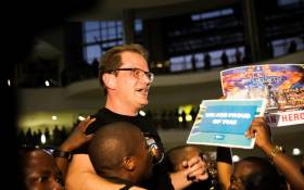 The conductor of the Ndlovu Youth Choir Ralf Schmitt is welcomed by South Africans gathered at the OR Tambo International Airport after the choir came in second on 'America's Got Talent'. Picture: Kayleen Morgan/EWN.