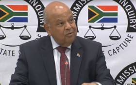 A video screengrab of Public Enterprises Minister Pravin Gordhan appearing at the Zondo commission of inquiry on 20 November 2018.