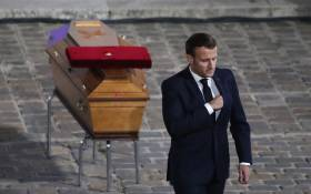 French President Emmanuel Macron pays his respects at the coffin of Samuel Paty's coffin inside Sorbonne University's courtyard in Paris on 21 October 2020, during a national homage to French teacher Samuel Paty, who was beheaded for showing cartoons of the Prophet Muhammad in his civics class. Picture: AFP