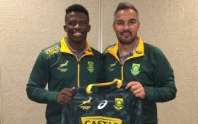 Sako Makata (left) receives his first Springbok 7s jersey from coach Neil Powell. Picture: @Blitzboks/Twitter
