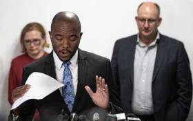 Mmusi Maimane announces his resignation as DA leader, with Helen Zille and Athol Trollip in the background, on 23 October 2019. Picture: Sethembiso Zulu/EWN