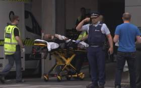 An image grab from TV New Zealand taken on 15 March 2019 shows a victim arriving at a hospital following the mosque shooting in Christchurch. Picture: AFP.