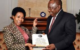 Retired Judge Yvonne Mokgoro hands over the report on the fitness of senior NPA officials to hold office to President Cyril Ramaphosa. Picture: @PresidencyZA/Twitter