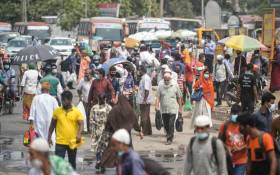 People leave the city as Bangladesh authorities ordered an eight-day lockdown to contain the spread of the COVID-19 coronavirus, in Dhaka on 12 April 2021. Picture: Munir uz zaman/AFP