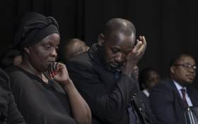 Anto Mpianzi and Ekila Guy Intamba, the parents of Enock Mpianzi, struggled to hold back their tears during a memorial service at Parktown Boys' High School. Picture: Xanderleigh Dookey/EWN