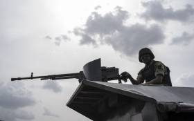 FILE: In this file photo taken on 17 April 2018 a member of the Nigerian Military Police sits on an armoured vehicle during the African Land Forces Summit (ALFS) military demonstration held at General Ao Azazi barracks in Gwagwalada. Picture: AFP.