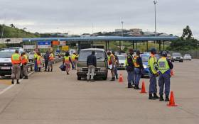 Law enforcement officers operate a roadblock on the N3 Marianhill Toll Plaza. Picture: @TrafficRTMC/Twitter
