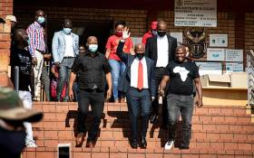 EFF leader Julius Malema (in red tie) at the Randburg Magistrates court on 28 October 2020 where he and EFF MP Mbuyiseni Ndlozi are on trial for allegedly assaulting a police officer in 2018. Picture: Xanderleigh Dookey/EWN.