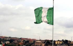 FILE: The Nigerian flag flies in Lagos. Picture: AFP.