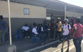 Matriculants wait to collect their senior certificate exam results at the Elswood High School in Elsies River, Cape Town on 23 February 2021. Picture: Graig-Lee Smith/Eyewitness News