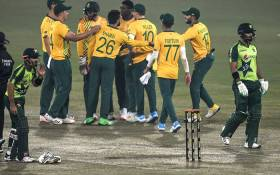 Pakistan's Hussain Talat (R) leaves the pitch after his dismissal as South African players celebrate during the first Twenty20 cricket match between Pakistan and South Africa at the Gaddafi Cricket Stadium in Lahore on 11 February 2021. Picture: Aamir Qureshi/AFP