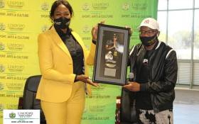Master KG (right) at the Limpopo Department of Arts & Culture, presenting MEC Thandi Moraka (left) with a plaque for his hit songs. Picture: Department of Sport, Arts and Culture Limpopo/Facebook