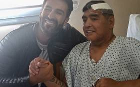 FILE: Argentine football legend Diego Maradona (R) shaking hands with his doctor Leopoldo Luque in Olivos, Buenos Aires province, Argentina, on 11 November 2020. Picture: AFP